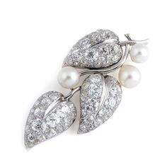 SUZANNE BELPERRON. A cultured pearl and diamond brooch.