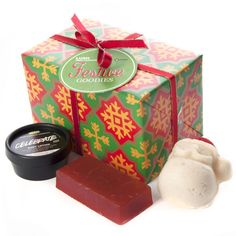 A classic addition to our cone-shaped gifts this year, Festive Goodies wraps up three limited edition shower products in gorgeous red, green and gold snowflake paper. We pack in our best-selling Karma soap, our new cognac and lime-scented Celebrate body lotion and our reformulated Sandy Santa body butter and scrub. The bright and festive packaging will look fantastic under the tree or poking out of a stocking, and it can be re-used as a decoration or a jaunty party hat!