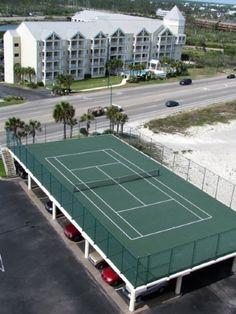 Tennis Court over a garage, what a brilliant idea!