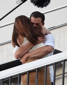 Hold me close: The couple could barely resist one another as they clutched on tight