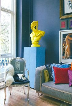 elle decoration. Love the pop art treatment to the bust w the david bowie-esque ziggy stardust lightning bolt