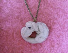 http://www.etsy.com/listing/84652503/falcor-the-luck-dragon-necklace?ref=sr_gallery_33_search_query=the+neverending+story_view_type=gallery_ship_to=ZZ_min=0_max=0_search_type=all  $35