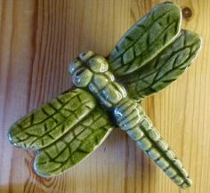 A green ceramic dragonfly to compliment the room.