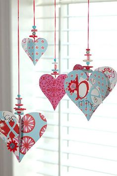 pretty paper & beaded heart ornaments dress up a window for Christmas or Valentine's