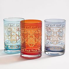 The Marrakech Tumblers add a striking note of color to your table. In rich jewel tones of teal, red and purple and with a gold metallic Morrocan-inspired pattern, these glasses bring a global feel to any table.  Marrakech Tumblers are crafted of glass  Set of 3  Colors include teal, red and purple