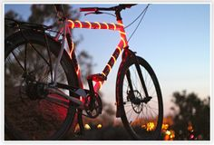 Bike Glow......wrap these lights around your bike for increased visibility up to 500 feet. Bright idea. $25. i want this so bad!