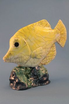 This is one of my sculptures from my White Raku Crackle series. Its also one of my larger sculptures in the series. The Yellow Tang was