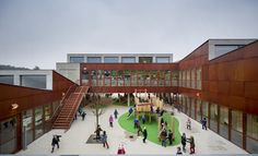 Kindy and Primary School in a mix of old and new buildings. Some lovely spaces.  Gekko+/+Moke+Architecten