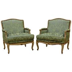 Pair of Attractive French Louis XV Style Painted and Satin Covered Bergeres | From a unique collection of antique and modern bergere chairs at https://www.1stdibs.com/furniture/seating/bergere-chairs/