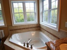Bathtub with window views