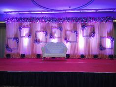 Jute backdrop adorned with white florals and frames- a neutral combination for any occassion. Designed and executed by Wishtree Weddings Engagement Stage Decoration, Wedding Hall Decorations, Marriage Decoration, Ceremony Decorations, Flower Decorations, Reception Stage Decor, Wedding Reception Backdrop, Wedding Mandap, Event Decor