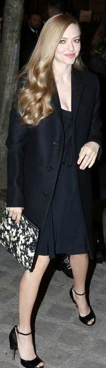 Who made  Amanda Seyfried's black coat, bow dress, and wedge pumps?
