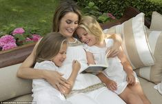 Idyllic: Letizia and her daughters Leonor and Sofia pictured in the royal gardens in an official photo taken during summer 2012