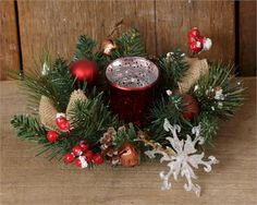 A holiday candle ring with a votive