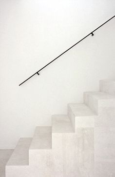 stone stairs with thin black railing.