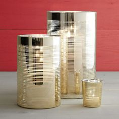 Luxe lighting at a great price. Clean-lined cylinders shine flickering candlelight through finely brushed rings of gold. A modern and elegant design with just the right amount of glitz. Mercury Glass Candle Holders, Hurricane Candle Holders, Votive Candles, Gold Glass, Household Items, Home Decor Accessories, Crate And Barrel, Seasonal Decor, Tea Lights