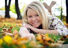 autumn senior - get her down in the leaves to get some color in the shot