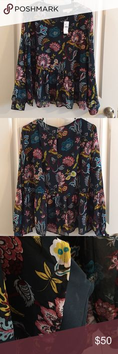 NWT!! Floral Peplum Blouse by Anne Taylor Loft Brand new with tags!  Blouse by Anne Taylor Loft. Fabric has a dark teal background with a gorgeous floral print.  Peplum style is figure flattering and flowy. Back key hole with button. As shown in the 3rd photo, the blouse is lined, though the sleeves are sheer.  Sleeves have button closure. Size M.  Custom bundle discounts available! Make an offer through the app! LOFT Tops Blouses