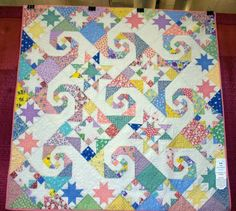 Shakespeare in the Park made by Debbie Davis from 1930s style fabric. Quilted by Donna Titsworth. The pattern was designed by Judy Martin for her book, The Creative Pattern Book.  Great use of color!