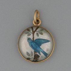 A late 19th Century reverse intaglio bird pendant charm