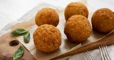 Homemade fried Arancini with basil on a rustic wooden board, sid - Stock , Italian Rice, Arancini, Rice Balls, Mozzarella, Basil, Muffin, Homemade, Rustic, Breakfast