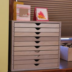 Store cards and other decor on top of your Drawer Cabinet.