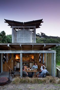 Outdoor living space Header tank tower weathered timber exposed structure sliding timber screens Herbst Bach by Herbst Architects
