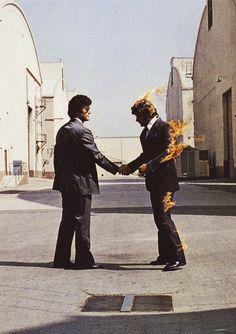 Wish You Were Here | Pink Floyd  Not my favorite album of theirs, but you gotta admit that the album artwork is awesome.