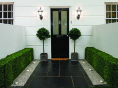 Pavestone Black Kadapha Limestone Paving. Sealed to retain a 'deep black' luster.