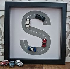 Creative personalized boy letter with cars on it.