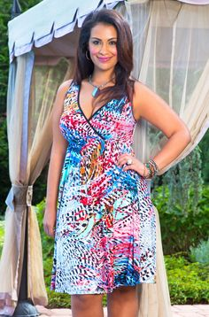This Always For Me Cover Plumes Wrap Dress features one of our best selling bodies with it's wrap style top and flattering A Line bottom. The pattern and combination of colors gives this sleeveless p