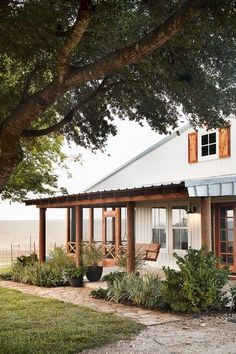 This front porch is really what gave this home's exterior the farmhouse look they wanted, and I have no doubt they'll spend plenty of time out there. Our carpenter, Clint, built the porch swing especially for this couple and with this front porch in mind.