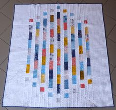 """Lovely Modern Totems quilt made by @mrcharbonneau   from Quilt Matters using Figures by Brigitte Heitland from Zen Chic for Moda Fabrics United Notions fabric and for the background Robert Kaufman Fabrics Kona.   """"For the quilting, I used Aurifil #2024 for doing straight-line quilting and some wavy-line stitching with my walking foot.""""  To read more please visit http://quiltmatters.blogspot.com/2014/12/tgiff-it-figures-its-modern-totems.html"""