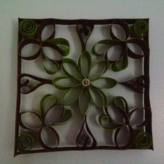 Wall art made with paper towel and toilet paper rolls.