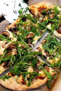 """Arugula and Mushroom White Pizza  For a whole grain alternative: replace the white flour with spelt flour and add 1 tsp raw apple cider vinegar to the """"200ml water"""" step in the recipe. The rest is the same."""