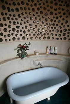 Jacobsen Earthship bottle wall and Tub by Earthship Kirsten, via Flickr