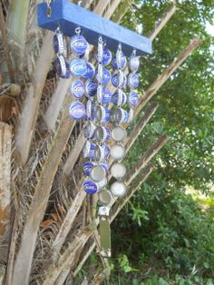 ♥♥♥ ♫ ♪ Upcycled Windchimes. Base made of painted wood with Bottle Caps (and a bottle opener) winding in the wind. ♫ ♪