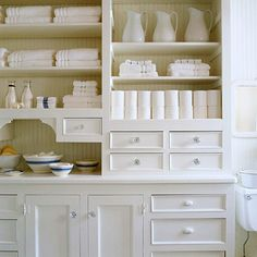 Neat and Clean- This crisp white bathroom hutch with crystal knobs looks fresh and organized. Plenty of shelves and drawers neatly store a plethora of towels and supplies Country Farmhouse Decor, Cottage Farmhouse, White Farmhouse, Farmhouse Plans, Farmhouse Style, Bathroom Storage, Bathroom Organization, Bathroom Shelves, Bathroom Ideas