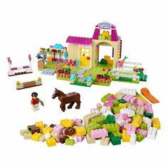 The colorful LEGO® Juniors Pony Farm has everything a horse needs, from grooming accessories to jumps and a cozy cottage for her rider.