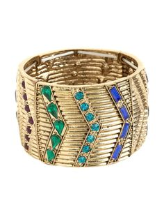 The Midas touch gets a shot of graphic glamour in this statement cuff, which features a cool chevron motif cast into bold gold. The faceted crystals in vibrant and vivid colors only up the allure.  via @baublebar
