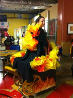 UMSL Bookstore homecoming cart with a Hunger Games theme! Love the Cart on Fire. Great use of tissue paper.