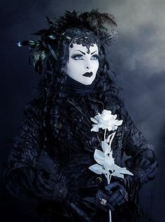 Black witch in neo-Victorian outfit
