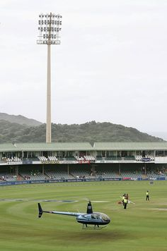 EAST LONDON, SOUTH AFRICA - FEBRUARY 9: A helicopter dries the outfield prior to the start of the 5th One Day International match between South Africa and England on February 9, 2005 at Buffalo Park in East London, South Africa. One Day International, Test Cricket, Pursuit Of Happiness, February 9, The Outfield, East London, Pitch, South Africa, Buffalo