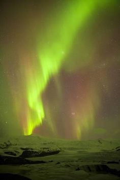 Photographic Print: Iceland, Fjallsarlon. the Northern Lights Appearing in the Sky at Fjallsarlonll. by Katie Garrod : 24x16in