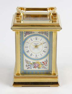 LOT:733 | A Halcyon Days enamel carriage clock.