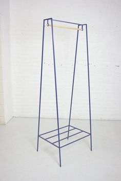 A blue steel powder coated clothes rail called 'A'. Designed by andNew. Fine steel clothes rail / wardrobe. www.andnew.co.uk