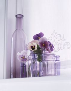 High-Res Stock Photography: Pansies in Purple Vase