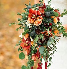 Hanging fall bouquet with orange flowers and greenery
