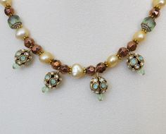 A personal favorite from my Etsy shop https://www.etsy.com/listing/267657515/green-and-bronze-necklace-with-german
