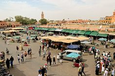 5. Jemaa El Fna Square - This is one of the best-known squares in Africa and definitely something you picture when thinking of Marrakech. During the day it's filled with buskers, orange juice stands, and shops, and in the evening it transforms into a huge outdoor food court. (21 Fascinating Things to Do in Marrakech Morocco).